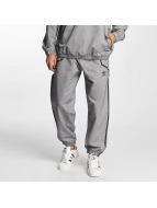 adidas Спортивные брюки Taped Wind серый