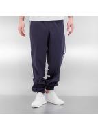 adidas Спортивные брюки CLR84 Woven Tracktop синий