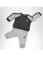 adidas Спортивные костюмы FL Quilted серый