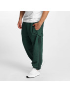 adidas Spodnie do joggingu Taped Wind zielony