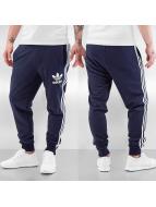 adidas tepláky CLFN Cuffed French Terry modrá