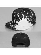 Decky USA Snapback Cap Splatter schwarz