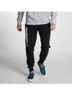New Era Spodnie do joggingu Team App Oakland Raiders czarny