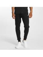 New Era Spodnie do joggingu Tech Series Oakland Raiders czarny