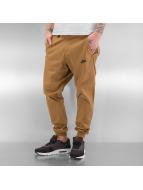 Nike Chinot/Kangashousut Sportswear Bonded beige