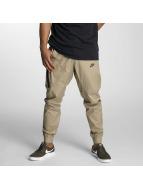 Nike Chinot/Kangashousut Sportswear Bonded khakiruskea