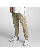 Nike Chinot/Kangashousut INTL khakiruskea