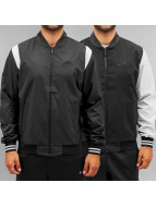 Nike College Jacke Woven Reversible Players schwarz