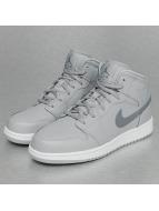 Nike sneaker Air Jordan 1 Mid grijs