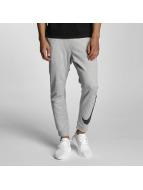 Nike Spodnie do joggingu NSW FLC Hybrid szary