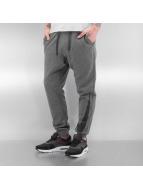Nike tepláky NSW FLC Hybrid šedá