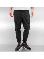 Nike Tygbyxor Sportswear Bonded svart